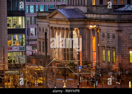 Manchester city centre skyline  view across the rooftops St Peters Square up Mosley Street Manchester Art Gallery and a Metrolink tram. - Stock Image