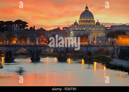 Tiber with Sant'Angelo bridge and the St. Peter's Basilica in Rome, Italy; the St. Peter's Basilica - Stock Image