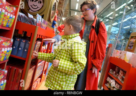 Hamleys toy shop at St Pancras Station in the Kings Cross area people customers child shopping for Lego at Christmas in London UK  KATHY DEWITT - Stock Image