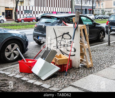 Discarded, trashed & abandoned goods on an urban pavement - Mitte, Berlin. - Stock Image