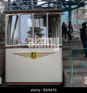 Dresden, Germany, December 15., 2018: Wagon of the oldest suspension railway in the world with low depth of field recorded at the mountain station - Stock Image