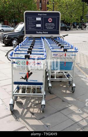 Kings Cross trolley point, outside Kings Cross Station, London England Britain UK - Stock Image