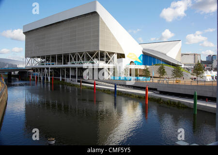 Aquatic Centre and River Lea on a sunny day at Olympic Park, London 2012 Olympic Games site, Stratford London E20 - Stock Image