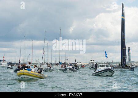 Portsmouth, UK. 25th July 2015. A huge fleet of small watercraft escort the America's Cup teams out of Portsmouth - Stock Image