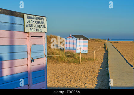Traditional beach huts on the shingle at Great Yarmouth - Stock Image