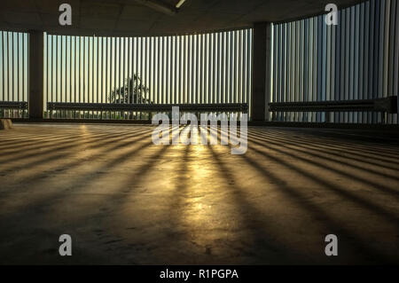 morning light in an empty undercover parking. - Stock Image
