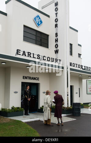 Chichester, West Sussex, UK. 13th Sep, 2013. Goodwood Revival. Goodwood Racing Circuit, West Sussex - Friday 13th September. Facade of the Earls Court motor show with couple looking at information near entrance. © MeonStock/Alamy Live News - Stock Image