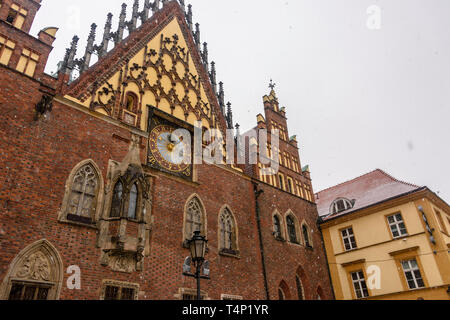 Clock on the outside of the gothic old town hall, Wrocław, Wroclaw, Wroklaw, Poland - Stock Image