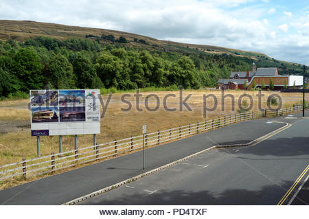 Ebbw Vale - former steelworks land awaiting redevelopment (Gwent Archives building in distance). Ebbw Vale, Blaenau Gwent, south Wales, UK. - Stock Image
