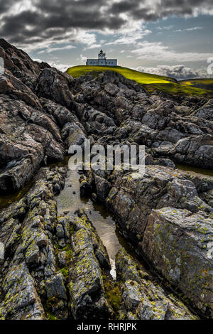 Strathy Point Lighthouse On Top Of Wild Cliffs At The Atlantic Coast Near Thurso In Scotland - Stock Image
