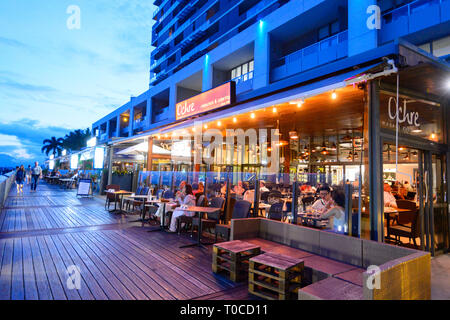 Ochre restaurant at the Marina in the evening, Cairns Wharf, Trinity Inlet, Far North Queensland, FNQ, QLD, Australia - Stock Image