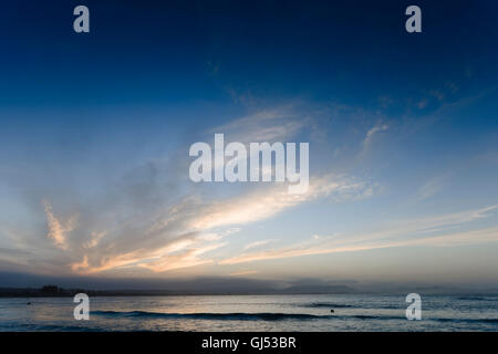 Evening skies over Byron Beach in Byron Bay. - Stock Image
