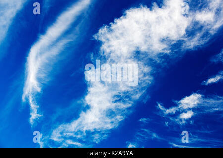 High Cirrus cloud, a sign of high winds in the upper atmosphere, over Cley, Norfolk, UK. - Stock Image