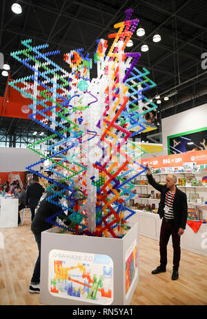 New York, USA. 16th Feb, 2019. Exhibitor representatives demonstrate a marbel maze game at the 116th Annual North American International Toy Fair at the Jacob K. Javits Convention Center in New York, the United States, Feb. 16, 2019. The toy fair, held from February 16 to 19 this year, gathered more than 1,000 toy exhibitors and hundreds of thousands of toys and youth entertainment products to retail outlets and trade guests from over 100 countries and regions. Credit: Wang Ying/Xinhua/Alamy Live News - Stock Image