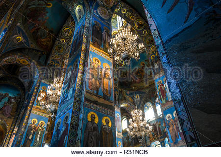 Inside the Church of the Savior on Spilled Blood (Cathedral of Resurrection of Christ) depicting religious scenes in mosaics on the walls and ceilings - Stock Image