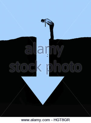 Businessman looking down into arrow shaped hole in ground - Stock Image
