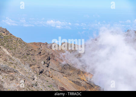 Above the clouds and geological landscape at Roque de los Muchachos, La Palma Island, Canary Islands, Spain - Stock Image