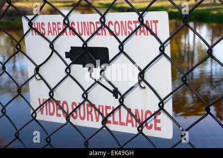 Warning sign indicating that this area is under constant video surveillance. Note the incorrect spelling of surveillance. - Stock Image