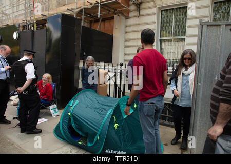 London, UK. 17th June 2019. Richard Ratcliffe on hunger strike in front of the Iranian embassy in London in protest of the detention of his wife Nazanin Zgahari in Iran over spying allegations. Richard is forced to put his tent forwards as builders are planning to pressure clean the front of the building. Credit: Joe Kuis / Alamy - Stock Image