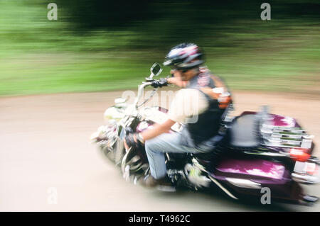 Man Riding Motorcycle, USA - Stock Image