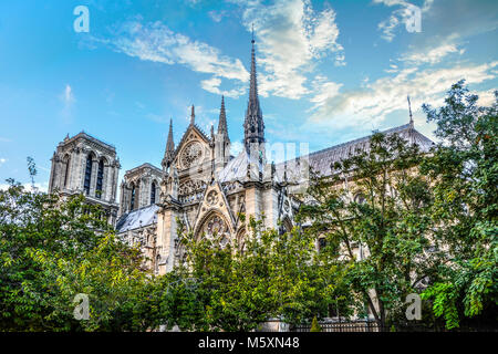 The ornate gothic architecture and spires on the side of Notre Dame Cathedral, Paris France on a sunny summer day - Stock Image