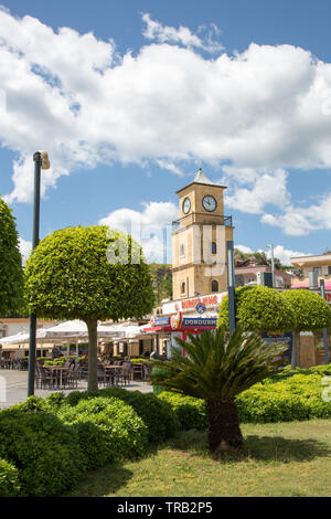 Burger King restaurant and the town clock tower in the Dancing fountains Square, Marmaris, Mugla province, Turkey - Stock Image