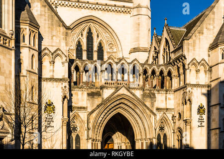 Winter sunlight on the main entrance of the Royal Courts of Justice, The Strand, London, UK - Stock Image