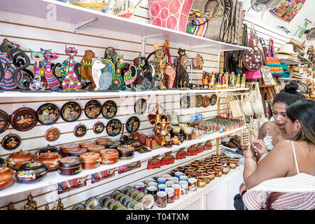 Cartagena Colombia Old Walled City Center centre Centro Playa de las Bovedas shopping display sale souvenirs gift shop Hispanic woman friends looking - Stock Image