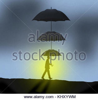 Businessman with sun shining below tiered umbrellas - Stock Image