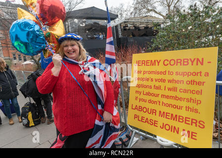 London, UK. 15th January 2019. A woman holding EU balloons by a warning to Jeremy Corbyn that he should support a people's vote. Groups against leaving the EU, including SODEM, Movement for Justice and In Limbo and Brexiteers Leave Means Leave and others protest opposite Parliament as Theresa May's Brexit deal was being debated.  While the two groups mainly kept apart, a small group, some in yellow jackets came to shout insults at pro-EU campaigners, while police tried to keep the two groups separate. Credit: Peter Marshall/Alamy Live News - Stock Image