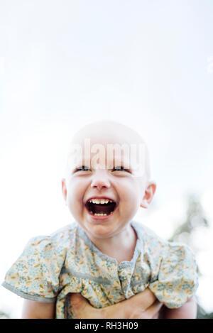 Laughing baby girl - Stock Image