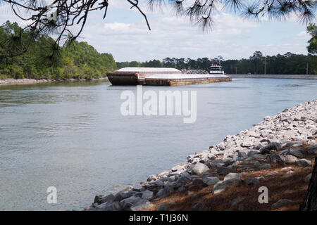 Westbound barge traffic on the Intracoastal Waterway at Orange Beach, Alabama, USA. - Stock Image