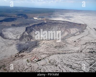 Aerial photo of Halemaumau and part of the Kilauea caldera floor at the summit as the volcano continues to erupt July 13, 2018 in Hawaii. In the lower third of the image, you can see the buildings that housed the USGS Hawaiian Volcano Observatory and Hawaii Volcanoes National Park Jaggar Museum. - Stock Image