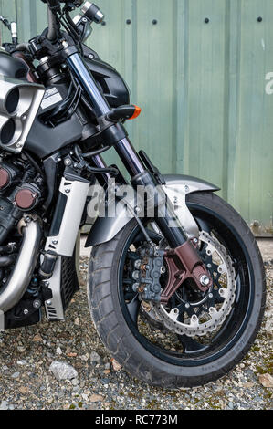 UK. Yamaha VMAX motorcycle, with a 4-cylinder liquid cooled 1679cc V4 engine. Front wheel, forks and shock absorbers, closeup - Stock Image
