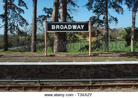 Broadway - place name sign at the railway station on the Gloucestershire & Warwickshire Railway heritage line. Broadway, Worcestershire, UK. - Stock Image