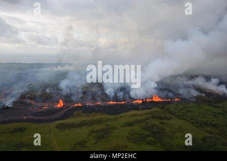 Lava fountains spew from fissure 20 caused by the eruption of the Kilauea volcano May 19, 2018 in Pahoa, Hawaii. - Stock Image