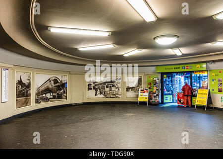 Berlin-Kreuzberg. Hallesches tor U Bahn. Underground railway station interior. Entrance hall & foyer with historic old photos.                   The U - Stock Image