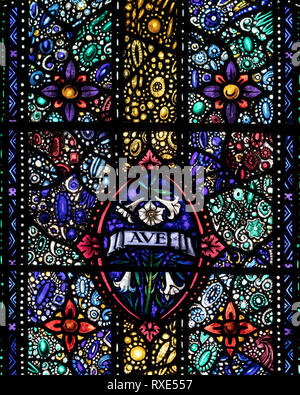 A Jewel-like part of the Annunciation window in St Oswald & St Edmund Church, Ashton-in-Makerfield, Great Manchester, UK - Stock Image