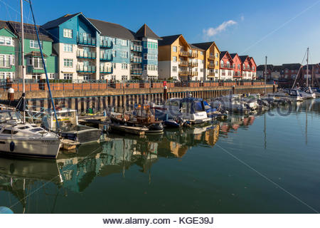 Exmouth Marina in Devon showing the boats and colourful appartments - Stock Image