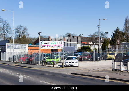 Small secondhand car dealer dealing in the lower end of the secondhand car market, advertising  the business as - Stock Image