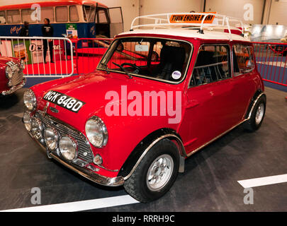 View of a 1965, Austin Mini Cooper S  with two engines, on display at the 2019 London Classic Car Show. - Stock Image