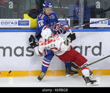 St Petersburg, Russia. 13th Sep, 2017. Avtomobilist Yekaterinburg's Nikolai Timashov (L) and SKA St Petersburg's Sergei Plotnikov fight for the puck in their 2017/18 KHL Regular Season ice hockey match at St Petersburg's Ice Palace. Credit: Alexander Demianchuk/TASS/Alamy Live News - Stock Image
