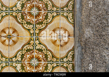 traditional decorative ceramic tiles on the exterior of a building in Porto, Portugal. - Stock Image