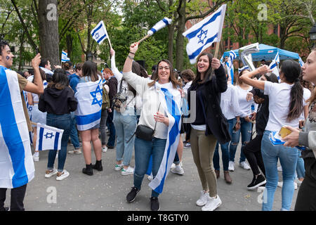 An Israeli & American young lady dance happily at the Israel Independence Day celebration in Washington Square Park in Manhattan,  NYC. - Stock Image