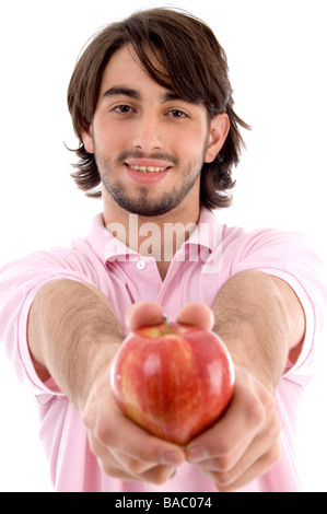 young man showing apple - Stock Image