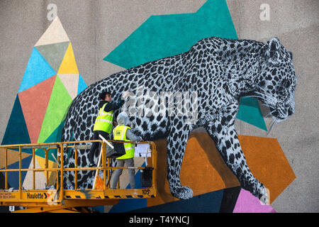 Artists Katie Gutherie (left) and Hama Woods create a mural at this year's Nuart Aberdeen Festival. - Stock Image