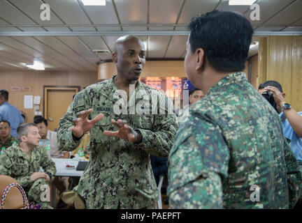180714-N-OU129-251 SAN FERNANDO CITY, Philippines (July 14, 2018) Capt. Lex Walker, Commodore, Destroyer Squadron 7, discusses engagement activities with Philippine Navy Commodore Nichols Driz, Commander, Naval Forces Northern Luzon, at the closing ceremony of Maritime Training Activity (MTA) Sama Sama 2018 aboard Philippine Navy ship BRP Tarlac (LD-601). The week-long engagement focuses on the full spectrum of naval capabilities and is designed to strengthen the close partnership between both navies while cooperatively ensuring maritime security, stability and prosperity. (U.S. Navy photo by  - Stock Image