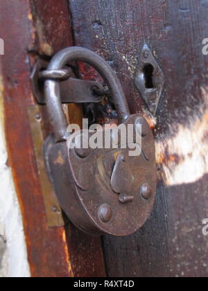A shot of an old rusted metal lock - Stock Image