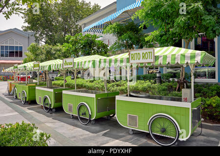 Food carts. Unmanned line of mobile food carts in a Thailand shopping mall forecourt. Southeast Asia - Stock Image