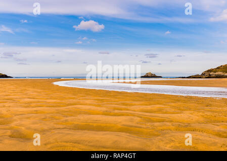 River flowing over Crantock Beach, Newquay, Cornwall, UK - Stock Image